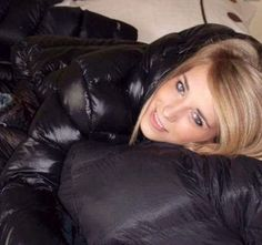 Blonde in pile of shiny down