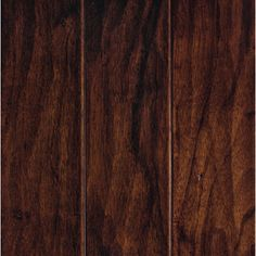 #65. TOO DARK AT HOME: Mohawk Pienza 5-in W Prefinished Hickory Engineered Hardwood Flooring (Cognac Hickory). Feels a little bumpy, beveled, some natural pitting. Color quite dark, uniform.