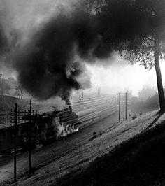 Toni Schneiders: Train in landscape. 1950s