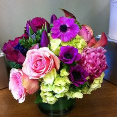 Vibrant mix of roses, anemones, callas, peonies and hydrangea. Color palette of pink, fuschia, and green.