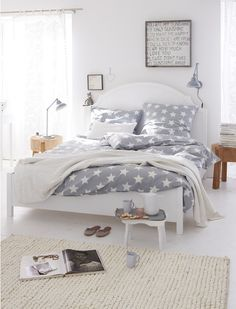 Doesn't get better than a white bedroom with contemporary wood furniture, pale flooring and graphic grey and white print duvet set, love it.