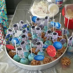 Galaxy and Astronaut cake pops and chocolate crackles for Space birthday party.