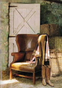 Even the Manor's barn has a comfy leather  chair to sit in and pull on your boots......