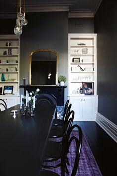 Before & After: a Victorian terrace becomes a beautiful contemporary home: Hing specified Resene's 'Double Stack' paint for dining room walls to conceal their imperfect state. Cut crystal decanter pendants by Lee Broom twinkle in a setting of Thonet chairs and a Hay table.