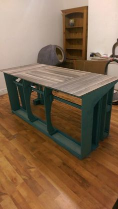 Dining table - made from an old sofa frame and a laminate floor table top!