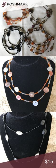 """2 For $12 sale-Bundle of 4 long necklaces. Bundle of 4 long necklaces. Fist one is made of shells and measure 56"""" long. Second is black and silver and measures 41"""" long. Third pic is of 2 coordinating necklaces in copper and brown tones. The first one measures 32"""" long and the second measures 41"""" long. All are intact in good condition. Jewelry Necklaces"""