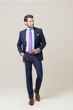 c4f7927c1741 Mit feinem Glencheck und einem dezenten blauen Überkaro sorgt dieser Anzug  detailverliebt für Abwechslung in Ihrer