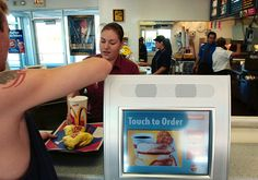 Getty Images                                               Self-serve ordering kiosks could help fast-food chains cut costs – and worker jobs – at a time when the minimum wage is rising. A sharp increase in Seattle's minimum wage may have cost low-income workers... -