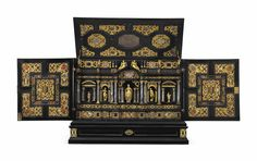 AN AUGSBURG GILT-METAL, ROCK-CRYSTAL AND PIETRE DURE-MOUNTED EBONY, KINGWOOD AND EBONISED TABLE-CABINET, CIRCA 1630-40. 30 in. (76 cm.) high; 36 in. (92 cm.) wide; 16 ½ in. (42 cm.) deep. -Christie's- Mirror Plates, Casket, A4 Poster, Poster Size Prints, Antique Furniture, Photo Wall Art, Decorative Boxes, Rock, Bronze