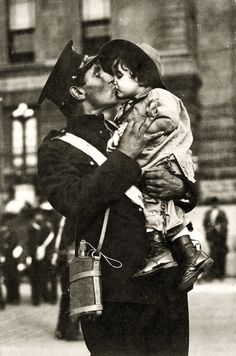 A Canadian Expeditionary Force soldier kisses his daughter goodbye before shipping off to WWI. Gaspé Harbour, Quebec, 1914.