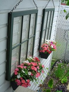 Re-purpose your old window frame by hanging it on a wall and placing flowers according the season. It will give your house a more vintage and stylish look.