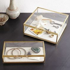 Living room accessories hunt is on: Glass Shadow Boxes....what small items could you display? The gold finish is just fine to mix, but this is meant as a the concept.