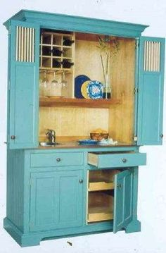 repurposed armoire.... This is what I need in my kitchen!!!!!