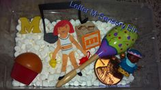 Letter M Sensory Bin. Great for learning letters and making them stick while getting in some new tactile experiences for kids. Perfect to use with letters of the week units