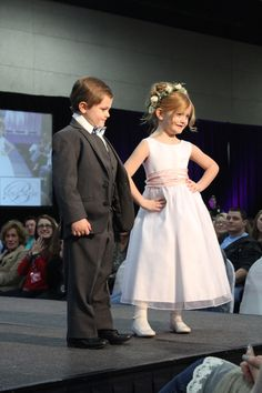 Flower girl dress by @thegildedgown and ring bearer tuxedo by @regaltuxedoknox during the second fashion show. Click to view more from the Winter 2016 Knoxville Pink Bridal Show®! | The Pink Bride® www.thepinkbride.com