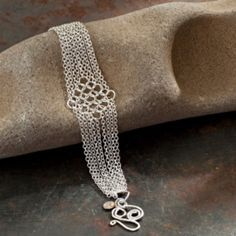 "FLOWING SILVER BRACELET ~ Like delicate handmade lace, the sterling silver chain maille ""diamond"" gives this sophisticated bracelet a delicate, feminine look. It also features a handcrafted sterling silver clasp.  $177.00  WorldWise Jewelry  www.worldwisejewelry.com"