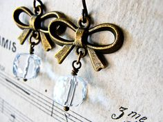 F A I R E S T... Icy quartz and brass bow earrings. Starting at $1 on Tophatter.com!