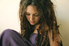 Wrapped dreadlocks and loose hair.