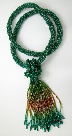 "Tubular Zulu continuous rope necklace with removable fringe<br /> Glass seed beads, drip beads<br /> Overall length 18"", without fringe 12"". Original Jewelry"