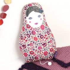 Matryoshka dolls in real Liberty® fabric with a music box inside. Charming and old fashioned melodies of the Beatles, Serge Gainsbourg, or Edith Piaf...