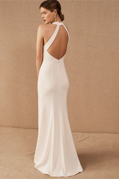 Channel your inner Meghan Markle with this sleek and sophisticated crepe dress featuring a high-neck and deep slit. This item is available for try-on in all stores; book an appointment at your local BHLDN shop.Only available at BHLDN Sleek Wedding Dress, Wedding Dresses Under 500, Minimalist Wedding Dresses, Casual Wedding, Bhldn Wedding Dress, Wedding Dresses Halter Top, Wedding Dresses Montreal, Simple Elegant Wedding Dress, Crepe Wedding Dress