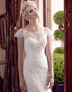 All over lace wedding gown with illusion top and cap sleeves. Casablanca  Spring 2015 Collection available at Hart's! www.hartstuxandgowns.com