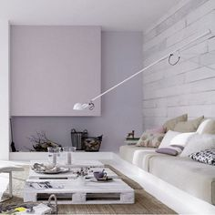 The FLOS 265 wall lamp by Paolo Rizzatto in white complements the bright and airy ambience in this modern interior with a pastel purple palette. Cozy Living Rooms, Living Room Decor, Pallet Furniture, Modern Furniture, Palette Deco, Furniture Inspiration, Living Room Designs, House Design, Interior Design