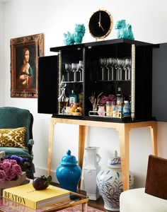 A large bar cabinet makes a statement in a small space while providing ample (and attractive) storage.