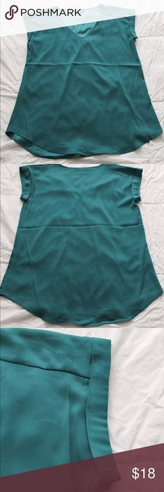 Express V-neck Top - Teal New Express v-neck blouse in a teal color. Never been used, but does not come with tags. Made of 96% polyester and 4% spandex. Express Tops Blouses