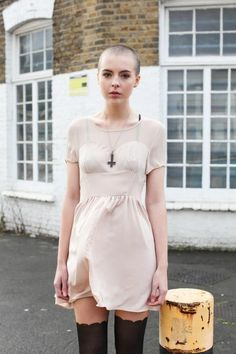 not exactly androgyny, but i love the femininity of this dress and stockings with the starkly shaved head.