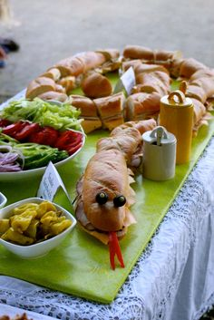 Carribean cold cuts- subway sandwiches shaped like a reptile with olive eyes etc