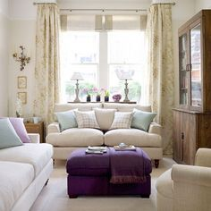 Cream living room with pastel cushions