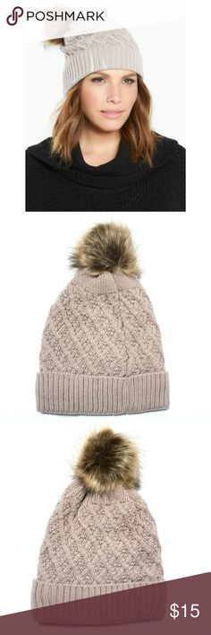 Price Drop⬇️ Torrid Beige Faux Fur Pom Beanie NWOT  We can't wait for a snow day now that we've got this beanie! The beige cable knit is buttery-soft and ultra stretchy. The faux fur pom on top is adorable.  One size  Acrylic/polyester Wash cold, dry low torrid Accessories Hats