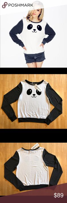 2X H.P.   WILDFOX Panda Sweater Featuring a scoop neck, banded hems, roomy fit. Soft vintage varsity blend: a pre-pilled, worn-in, distressed-feeling fabric.  47% Rayon, 47% Polyester, 6% Spandex NOTE: I had originally cut the tags to give to my daughter as a gift, with that said the tag is tided on. Never worn though. Will post picture if needed. Wildfox Sweaters Crew & Scoop Necks