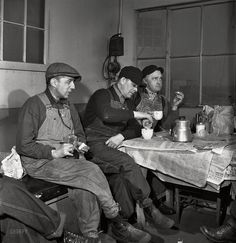 "Working Lunch: February 1943. ""Daniel Senise (center) at lunch in the work shanty at an Indiana Harbor Belt Line rail yard. With him are switchmen John McCarthy (left) and E.H. Albrecht."" Medium-format nitrate negative by Jack Delano. Click to view full size."