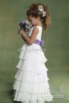 Tiered skirt flower girl dress with satin sash.