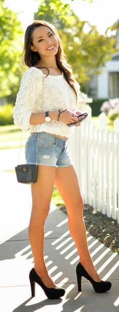 Gorgeous denim shorts jeans with top white roses blouse and black leather clutch and black high heels sandals the best way to show fashion & style