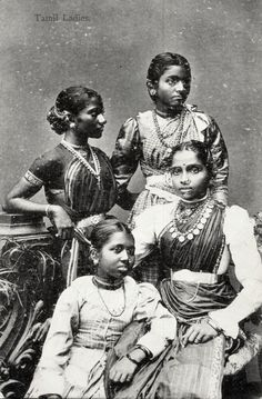 This slightly damaged postcard shows a neat mix of Western fashion and South Indian styling. Two of the girls wear their sarees over trendy blouses and the third has a traditional little choli - all three sporting loads of jewellery with tight belts the focal point. Seated lower down, the fourth girl appears to be in a basque bodice and skirt, a more old-fashioned Euro outfit. I especially like the checked saree with the satin blouse.