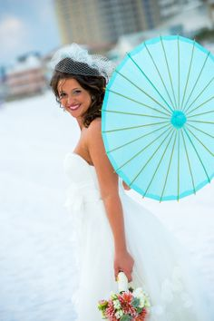 Beach bridal portraits with blue parasol