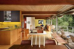 Design Therapy site image of a ultra-cool contemporary living space.  Open to the sea? Maybe not, but great finishes.