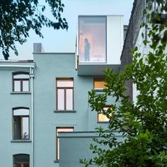 Kitchen extension projects from the top floor of a renovated Brussels house