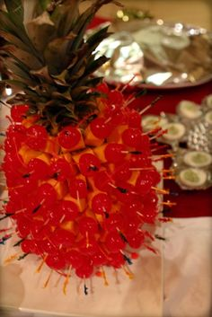 Tacky marachino cherries w/ cheese cubes attached to a pineapple.  Christmas party tacky.