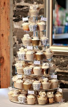 Beautiful gold and ivory cupcake tower  (Sweetopia).