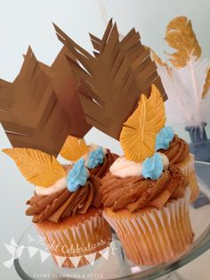feather topped cupcakes | In Flight: Dreamcatcher Dessert Table Inspiration
