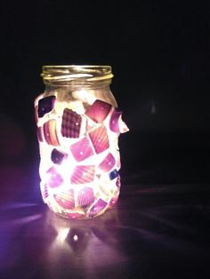 Broken bracelets, mason jars and you have the perfect candle light table piece
