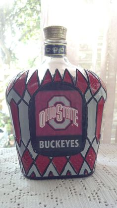My two favorite things. Ohio State Buckeyes Crown Royal bottle hand painted by PattiesPassion royal bottle crafts Ohio State Buckeyes Crown Royal bottle Hand Painted Glass OOAK Decorated Liquor Bottles, Liquor Bottle Crafts, Diy Bottle, Bottle Art, Wine Bottles, Glass Bottles, Crafts With Glass Jars, Mason Jar Crafts, Secret Santa