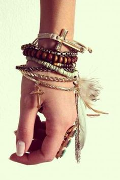 Feathers, Crosses, and beads- love feathers on a bracelet, I've never seen that before! So hippie chic!