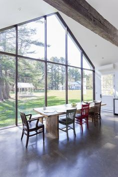 Kitchen glass wall overlooking water, apple trees and barn in the Floating Farmhouse Catskills vacation rental in upstate NY. White Farmhouse, Farmhouse Plans, Farmhouse Design, Modern Farmhouse, Modern Country, Country Style, Heated Concrete Floor, Concrete Floors, Hand Hewn Beams