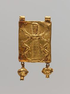 Gold pendant with Mistress of Animals | Greek | Archaic | The Met