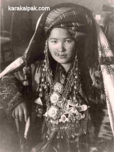 Central Asia | A young Karakalpak woman wearing a mixture of Karakalpak, Uzbek, and Tajik jewellery, probably 1930s. | The photograph looks staged. Reserve of the Karakalpak State Museum of Art named after Savitsky, No'kis.
